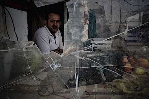 zoriah_iraq_war_baghdad_sadr_city_wall_merchant_shop_damage.jpg