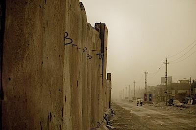 zoriah_iraq_war_baghdad_sand_storm_wall_sadr_city_father_son